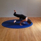 From prayer twist prep - lean & wriggle in - stretch your heart forward - hug your core - float your feet.