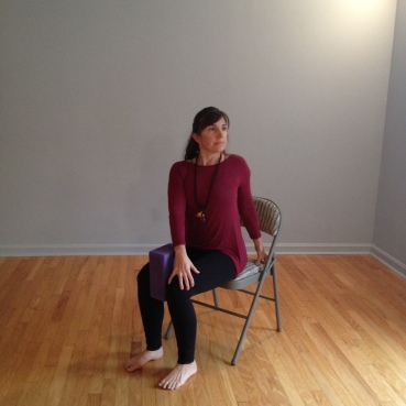 Use block between knees to remind you to keep hips even. Stretch tall. Then gentle twist.